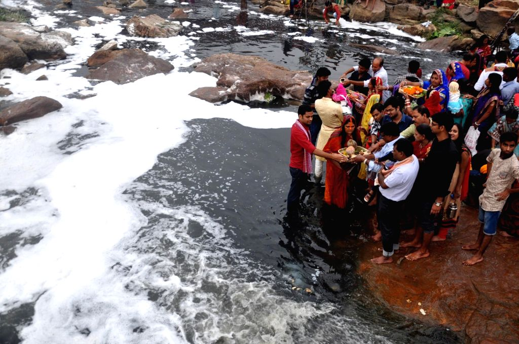 People perform Chhath rituals on the banks of Subarnarekha river in Ranchi, on Nov 17, 2015.