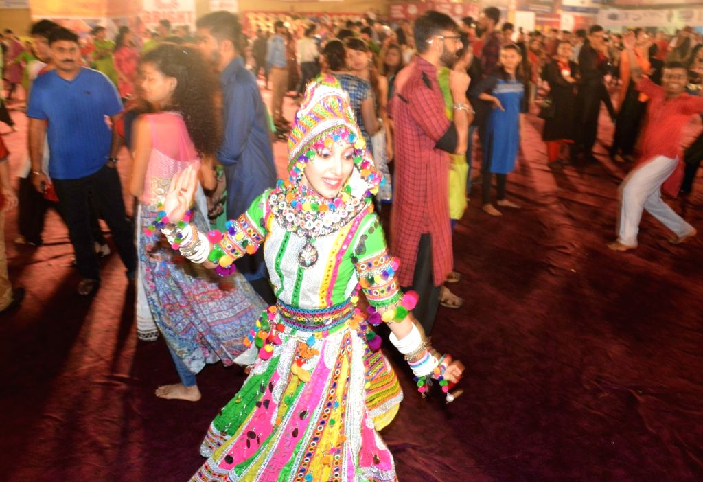 People perform Dandiya during Navratri in Mumbai.