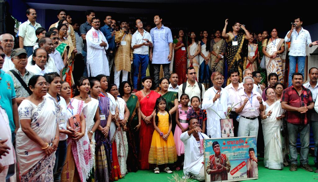 People perform during a programme organised on 88th birth anniversary of legendary singer Bhupen Hazarika in Guwahati on Sept 8, 2014.