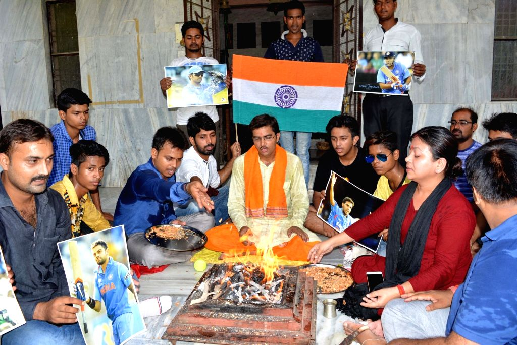 People perform havan to pray for India's victory in the ongoing 2017 ICC Champions Trophy match against South Africa in Varanasi, on June 11, 2017.