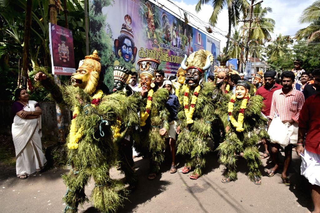 People perform Kummatti during Onam celebrations in Thrissur of Kerala on Sept 16, 2016.