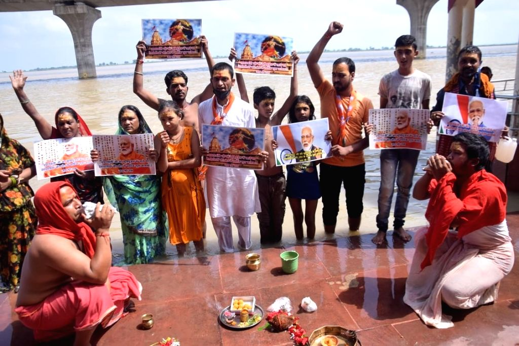 People perform rituals and offer prayers to Lord Ram on the banks of the Ganga river to mark the 'Bhumi Pujan' of Ram Temple in Ayodhya performed by Prime Minister Narendra Modi today; in ... - Narendra Modi