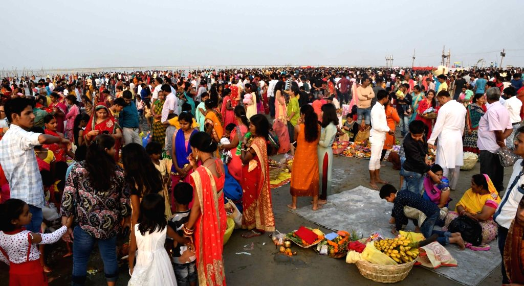 People perform rituals during Chaiti Chhath Puja celebrations, in Patna on April 11, 2019.