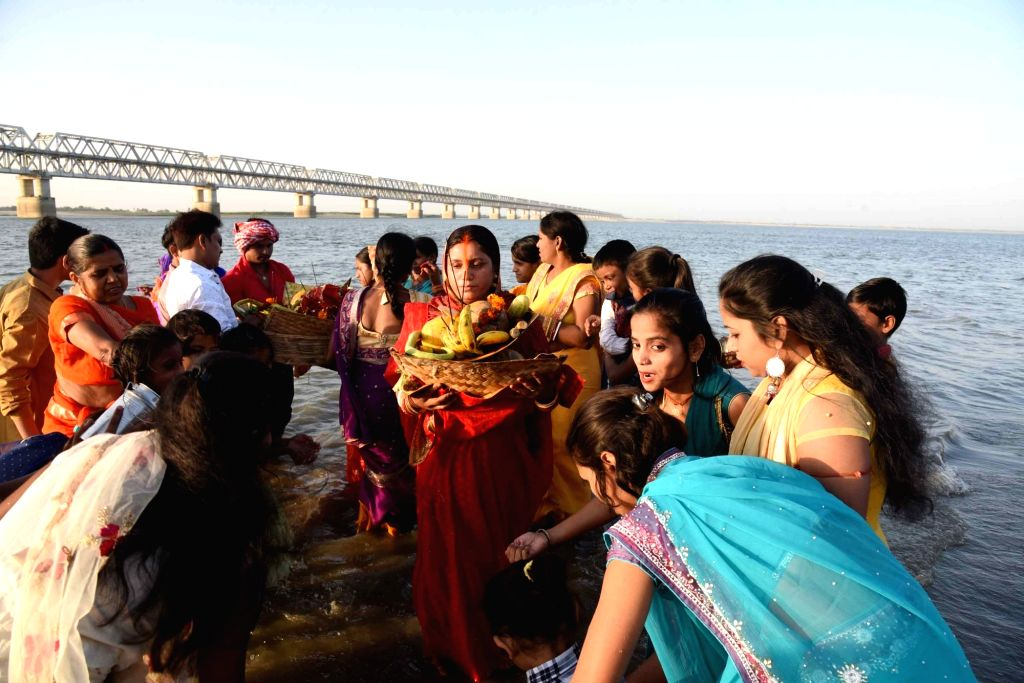 People perform rituals in the Ganga river during Chaiti Chhath celebrations amid countrywide lockdown imposed to contain the spread of novel coronavirus, in Patna on March 30, 2020.