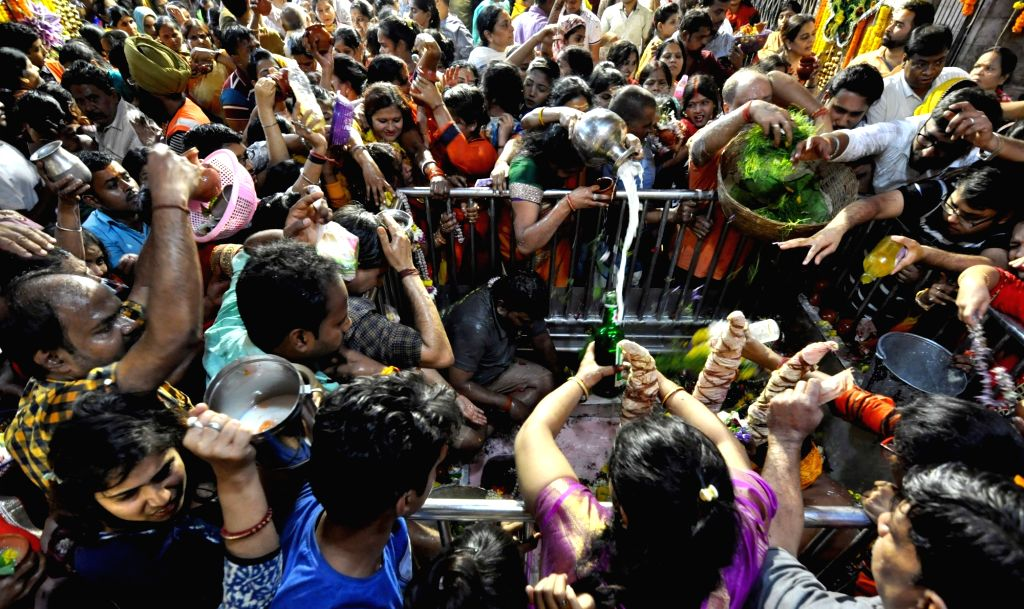 People perform rituals on Maha Shivratri in Kolkata, on March 4, 2019.