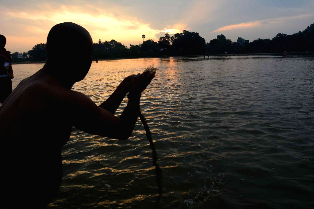 People perform rituals on the banks of the Phalgu river as `Pitripaksha`- a 16-day period when Hindus pay homage to their forefathers, begins in Gaya on Sept 9, 2014.