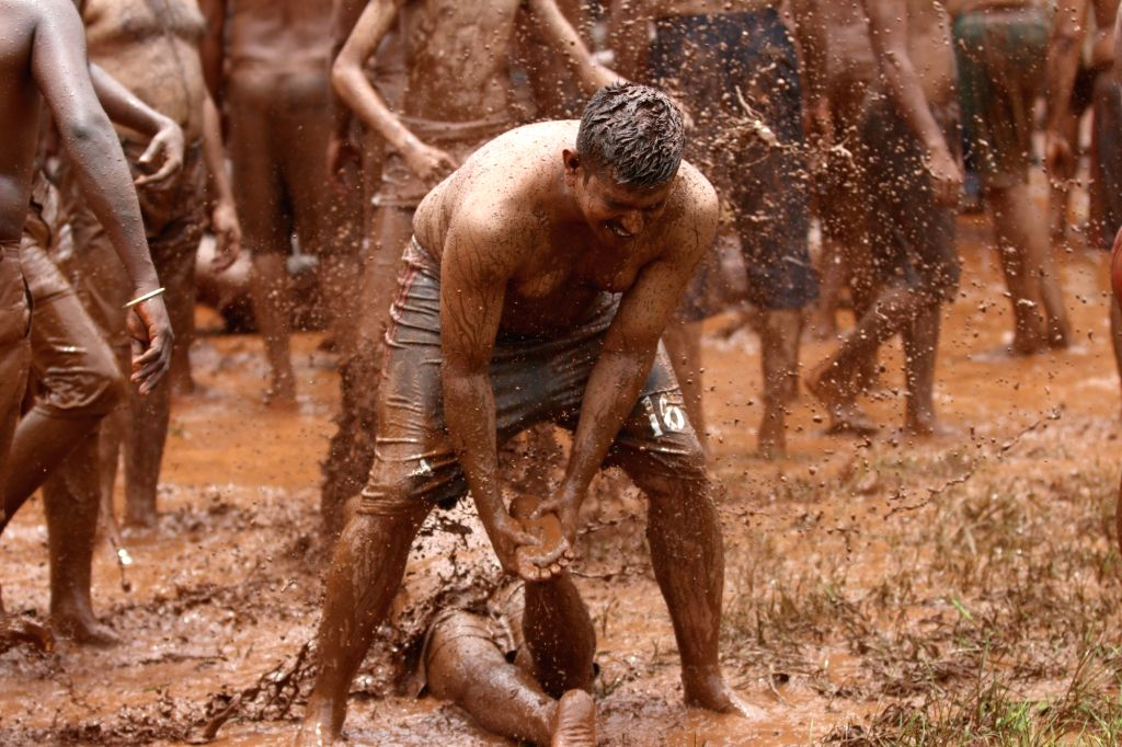 People play around in the mud during 'Chikhal Kalo' or 'Mud festival' celebrations in Goa's Mashel on July 24, 2018.