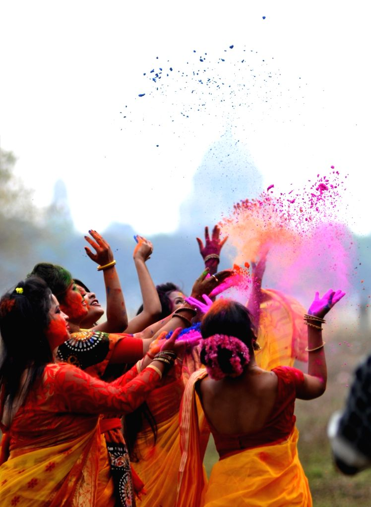 People play with color powders ahead of Holi at Maidan in Kolkata on March 5, 2017.