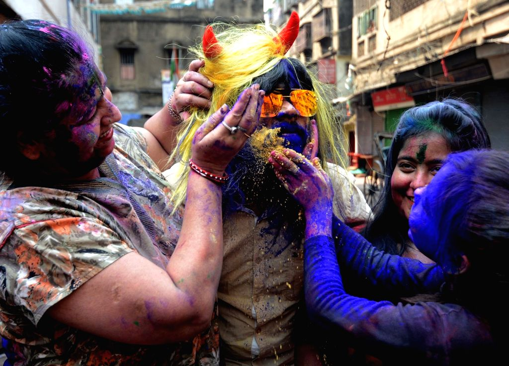People play with colour during Holi celebration in Kolkata on March 29, 2021