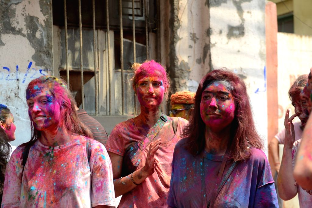 People play with colour during Holi festival in Kolkata on Sunday 28th March, 2021.