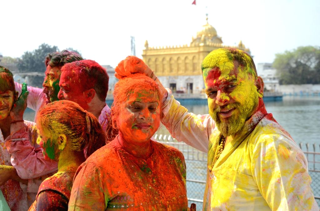 People  play with colours during Holi festival celebrations at Durgiana Temple in Amritsar on Sunday 28th March, 2021.