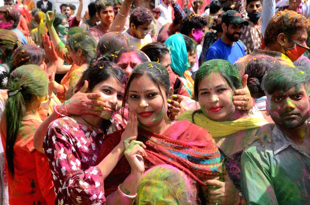 People  play with colours during Holi festival celebrations at a Temple in Amritsar on Sunday.