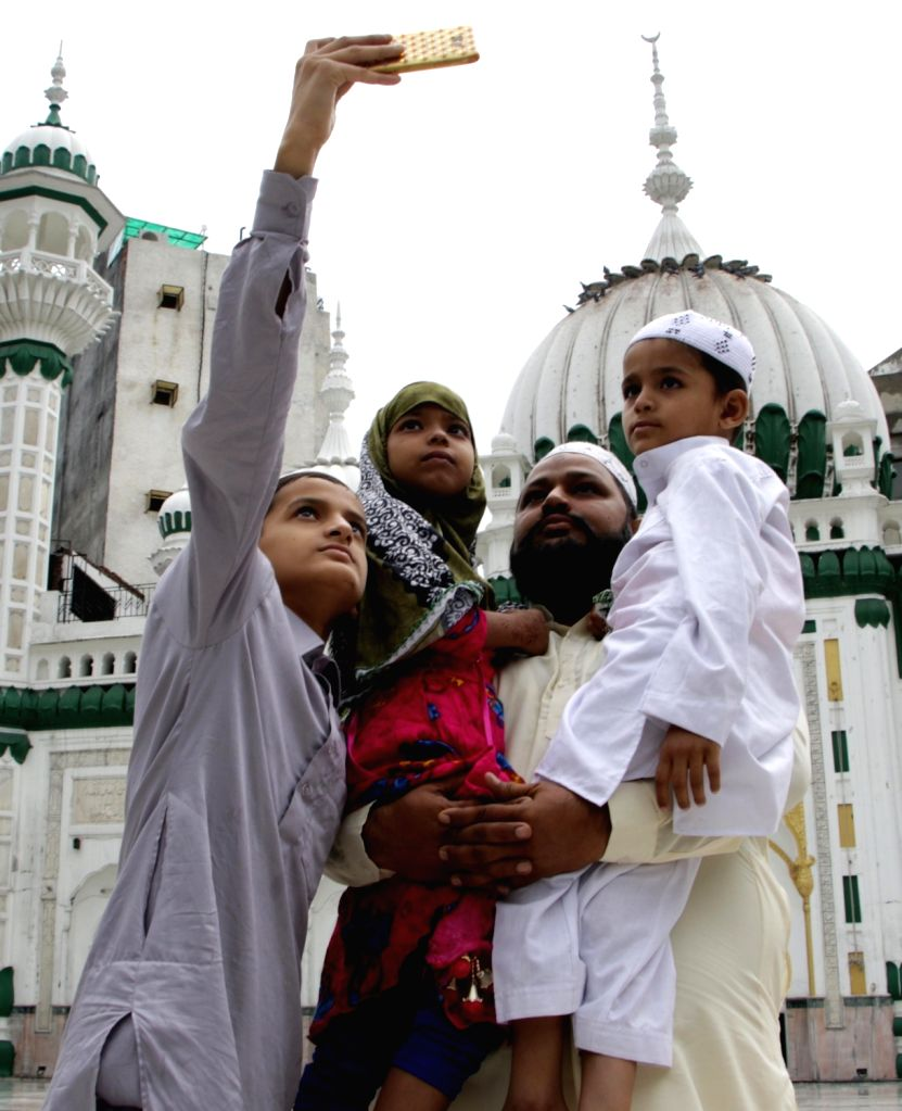 People pose for selfies at a mosque during Eid-Ul-Adha celebrations in Amritsar on Aug 1, 2020.