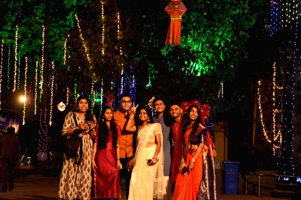 People pose for selfies during Diwali celebrations at Mumbai's Dadar on Nov 14, 2020.