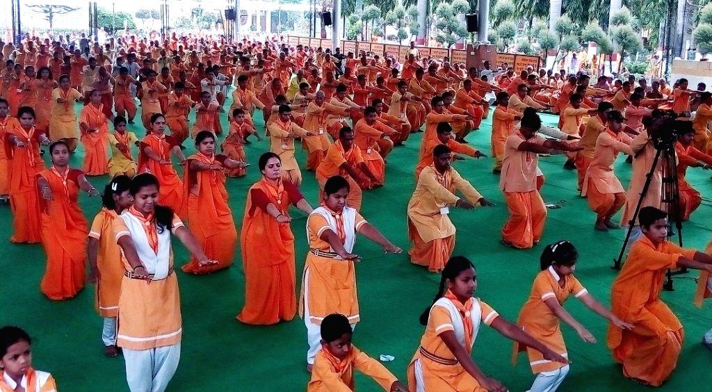 People practice yoga asanas -postures- on International Yoga Day at Shantikunj in Haridwar on June 21, 2017.
