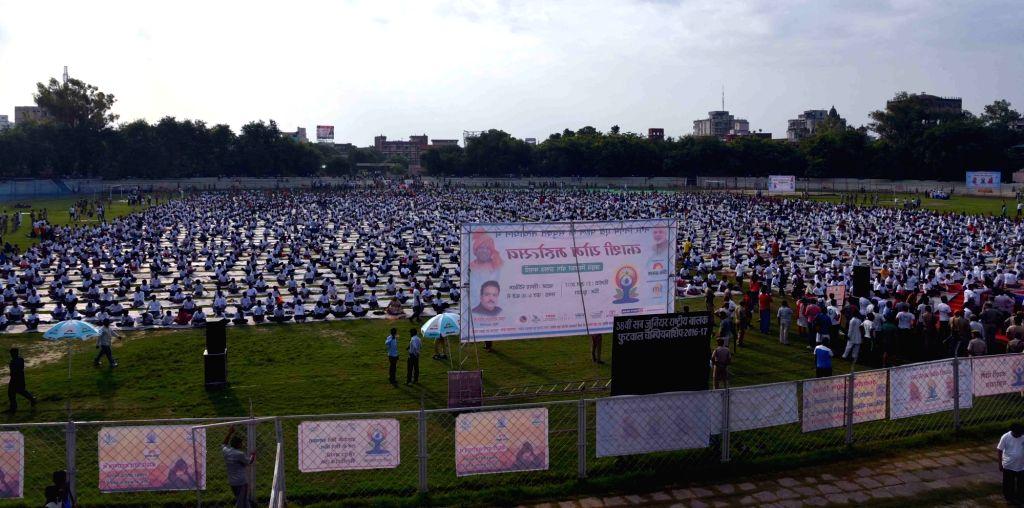 People practice Yoga Asans -postures- on International Yoga Day in Varanasi on June 21, 2017. (