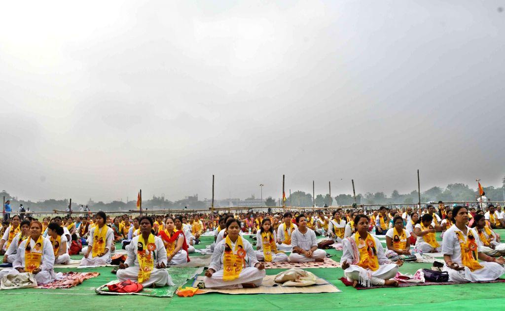 People practice Yoga Asans -postures- on International Yoga Day in Patna on June 21, 2017.