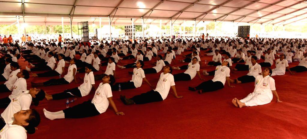 People practice Yoga Asans -postures- on International Yoga Day in Bhubaneswar on June 21, 2017.