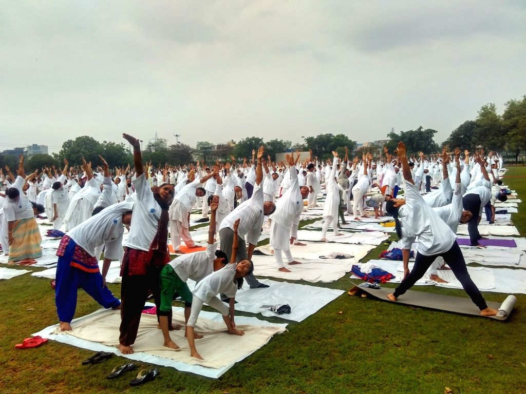 People practicing yoga on International Yoga Day at a sports complex in New Delhi on June 21, 2017.
