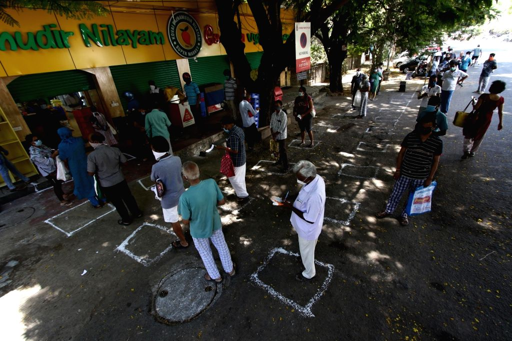People practise social distancing while purchasing essential commodities at a market on Day 6 of the 21-day countrywide lockdown imposed to contain the spread of novel coronavirus, in ...