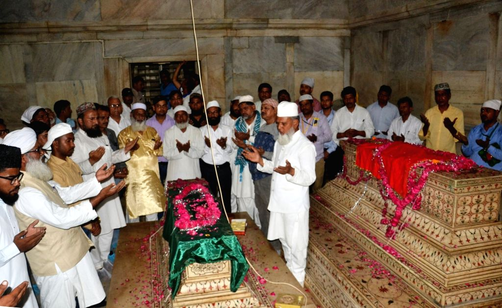 People pray at the graves of Mughal emperor Shah Jahan and his wife Mumtaz Mahal during Shah Jahan's Urs (birth anniversary) celebrations, at Taj Mahal in Agra on April 14, 2018.