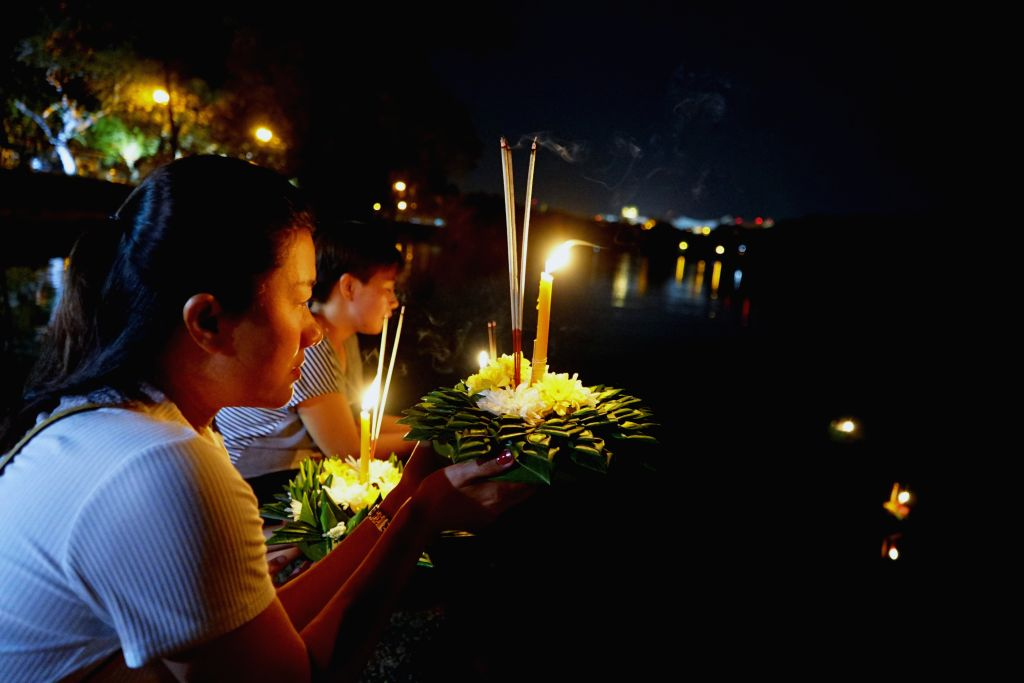 People prepare to release water lanterns in Bandar Seri Begawan, capital of Brunei, Nov. 11, 2019. The Thailand's traditional Loy Krathong Festival or ...