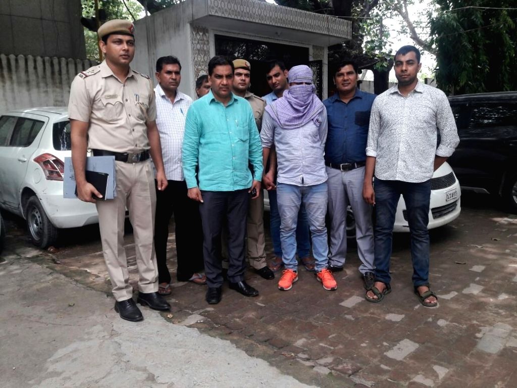 People present before press 26-year-old Chand Mohammad, who was arrested after a shootout near New Friends Colony area of south Delhi on July 5, 2017. A pistol and four cartridges were ...