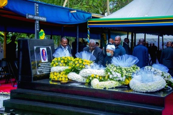 People present wreaths at the tomb of former Tanzanian President Magufuli in Chato, Tanzania, on March 26, 2021.
