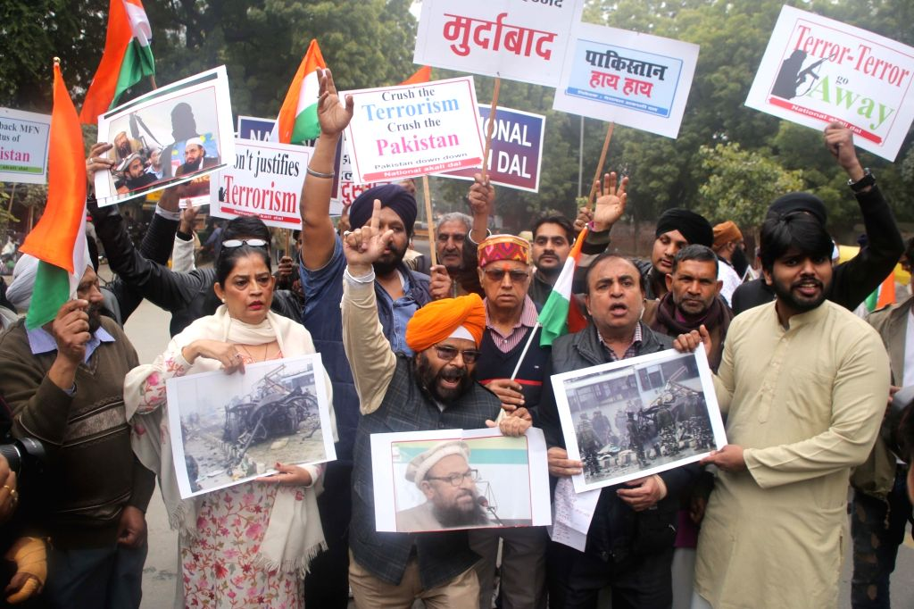 People protest against militant attack on a CRPF convoy in Jammu and Kashmir's Pulwama district in which 49 soldiers lost their lives; in New Delhi on Feb 16, 2019.