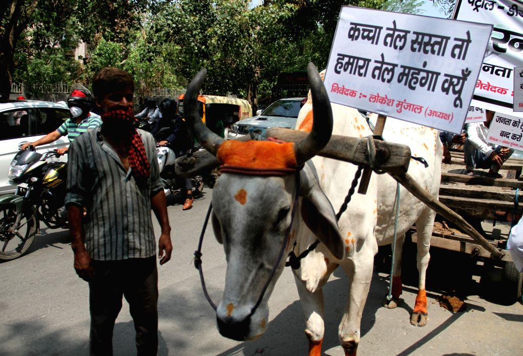 People protest against the hike in prices of petrol and diesel at Delhi's Karampura, on June 25, 2020.