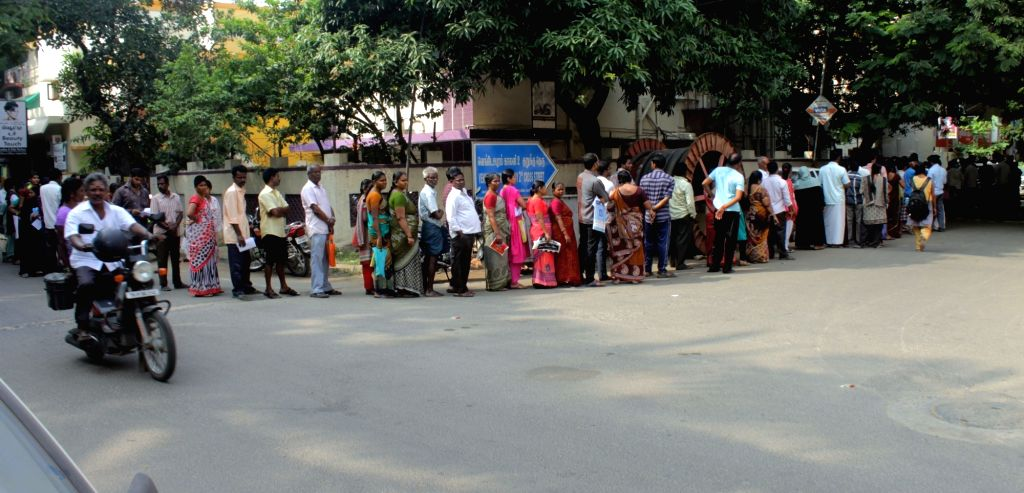 People queue outside a bank branch to exchange demonetised notes in Chennai on Nov. 12, 2016.