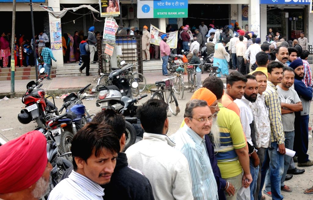 People queue outside a bank branch to exchange demonetised notes in Amritsar on Nov. 12, 2016.
