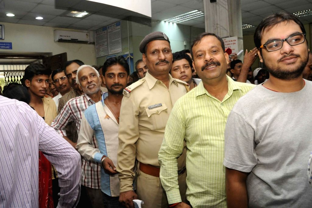 People queue outside a bank branch to exchange demonetised notes in Patna on Nov. 12, 2016.