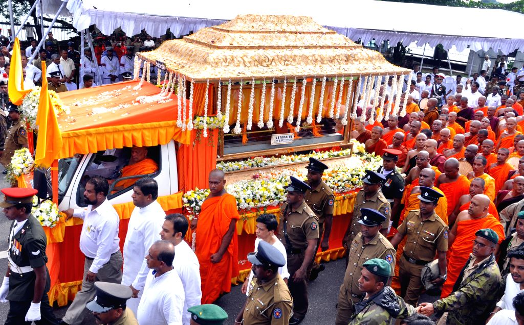 People queue to bid farewell to the Venerable Maduluwawe Sobitha Thero, an influential Sri Lankan Buddhist monk in Colombo, Sri Lanka, Nov. 12, 2015. Thousands of ...
