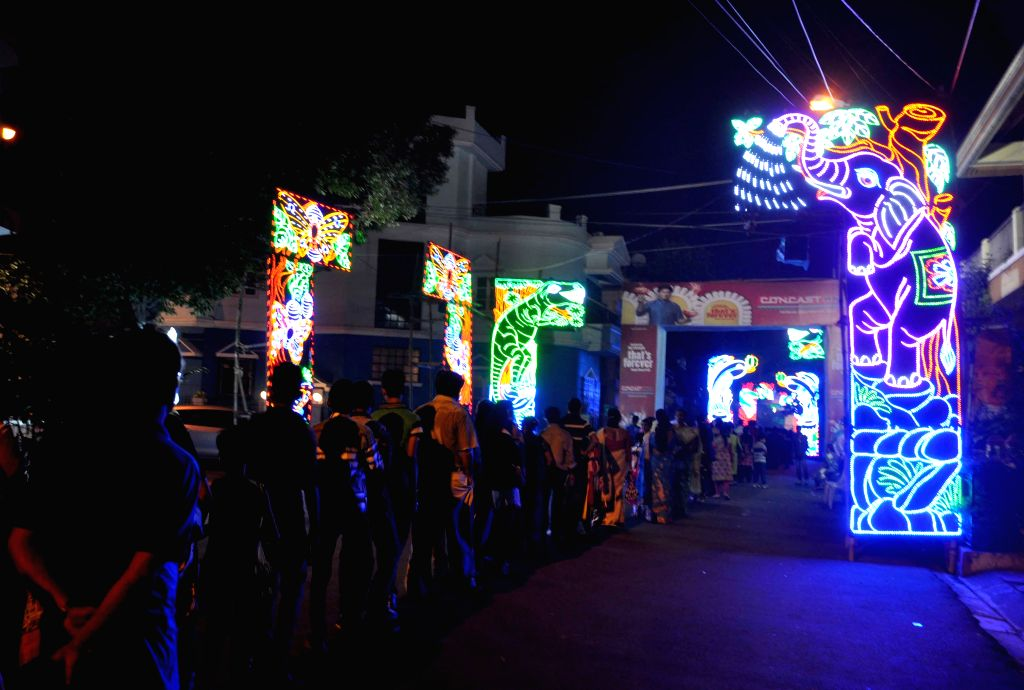 People queue up at a Durga Puja pandal in Kolkata, on Oct 21, 2015.