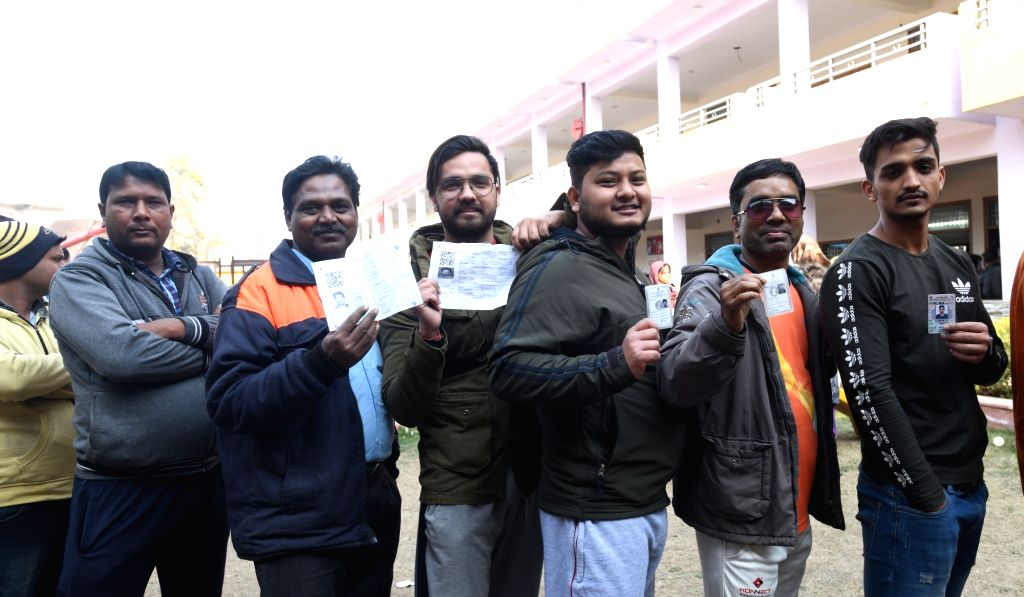People queue up at a polling station in East Delhi to cast their votes for the Delhi Assembly elections 2020 on Feb 8, 2020.