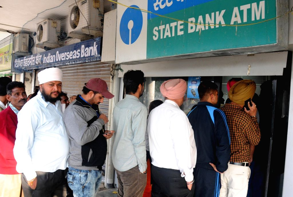 People queue up in front of an ATM kiosks in Amritsar on Nov 18, 2016.