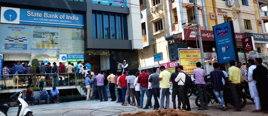 People queue up in front of an ATM kiosks in Hyderabad on Nov 26, 2016.