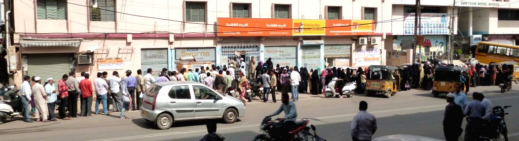People queue up outside a bank in Hyderabad on Nov 29, 2016.