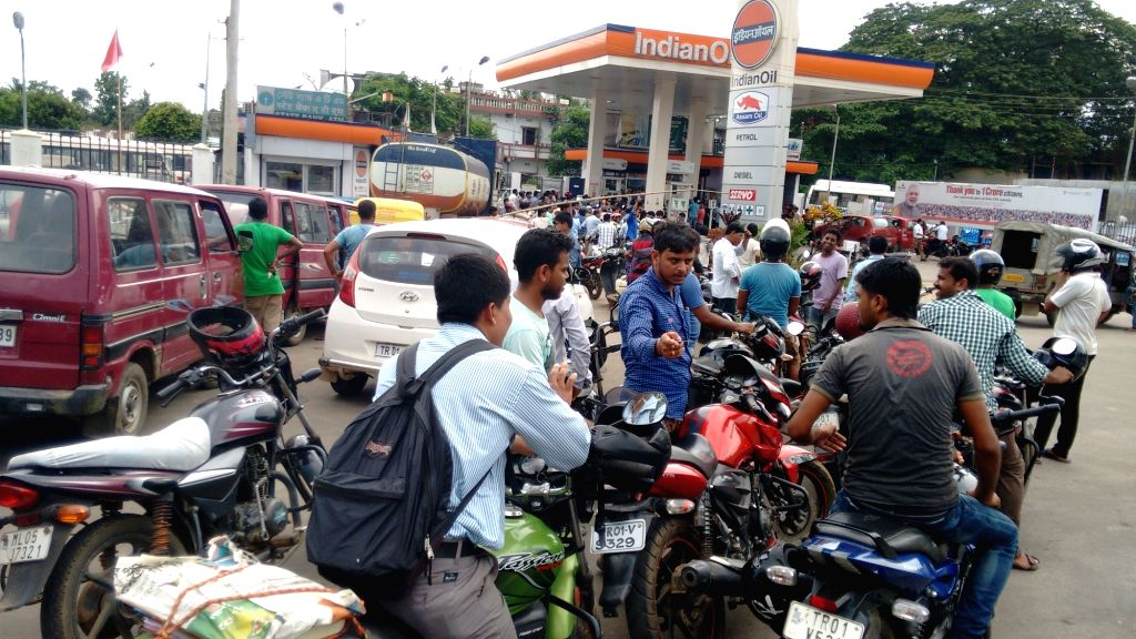 People queue-up outside a petrol station for refueling in Agartala June 25, 2016. Tripura is facing a fuel crisis as tankers are unable to reach the state due to the poor condition of the ...