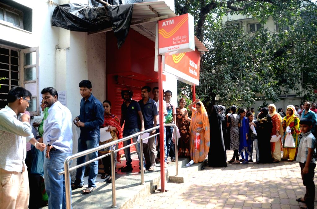 People queue up outside a Post Office to exchange demonetised notes in Mumbai on Nov. 13, 2016.