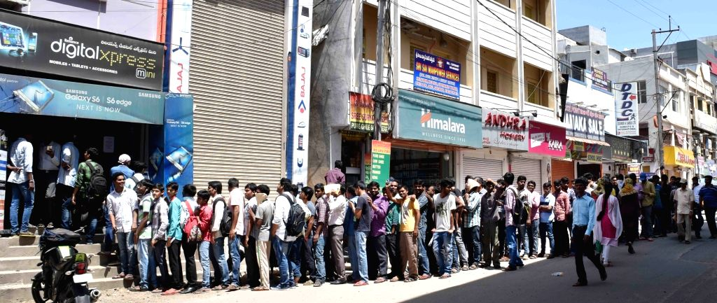 People queue-up outside a store to buy Reliance Jio SIM cards in Hyderabad on Sept 8, 2016.