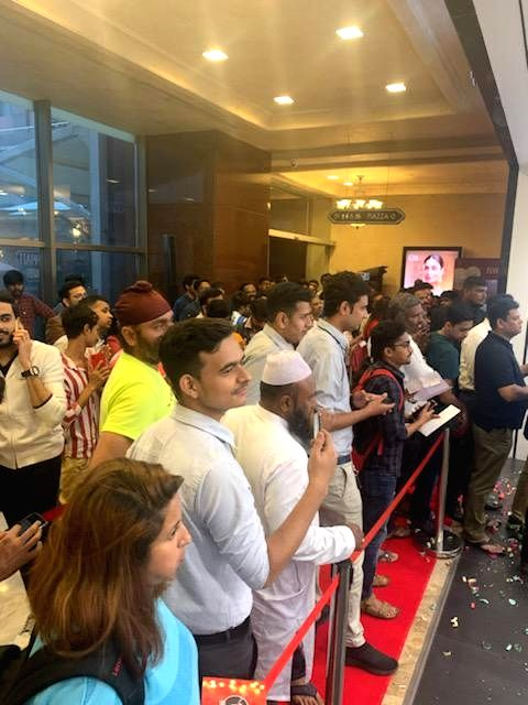 People queue up outside an Apple store to purchase iPhones after the iPhone 11, iPhone 11 Pro, and iPhone 11 Pro Max smartphones went on sale across both online and offline retail stores ...