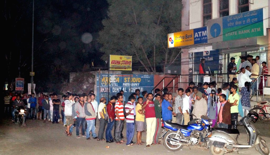 People queue up outside an ATM in Hyderabad on Nov 27, 2016.