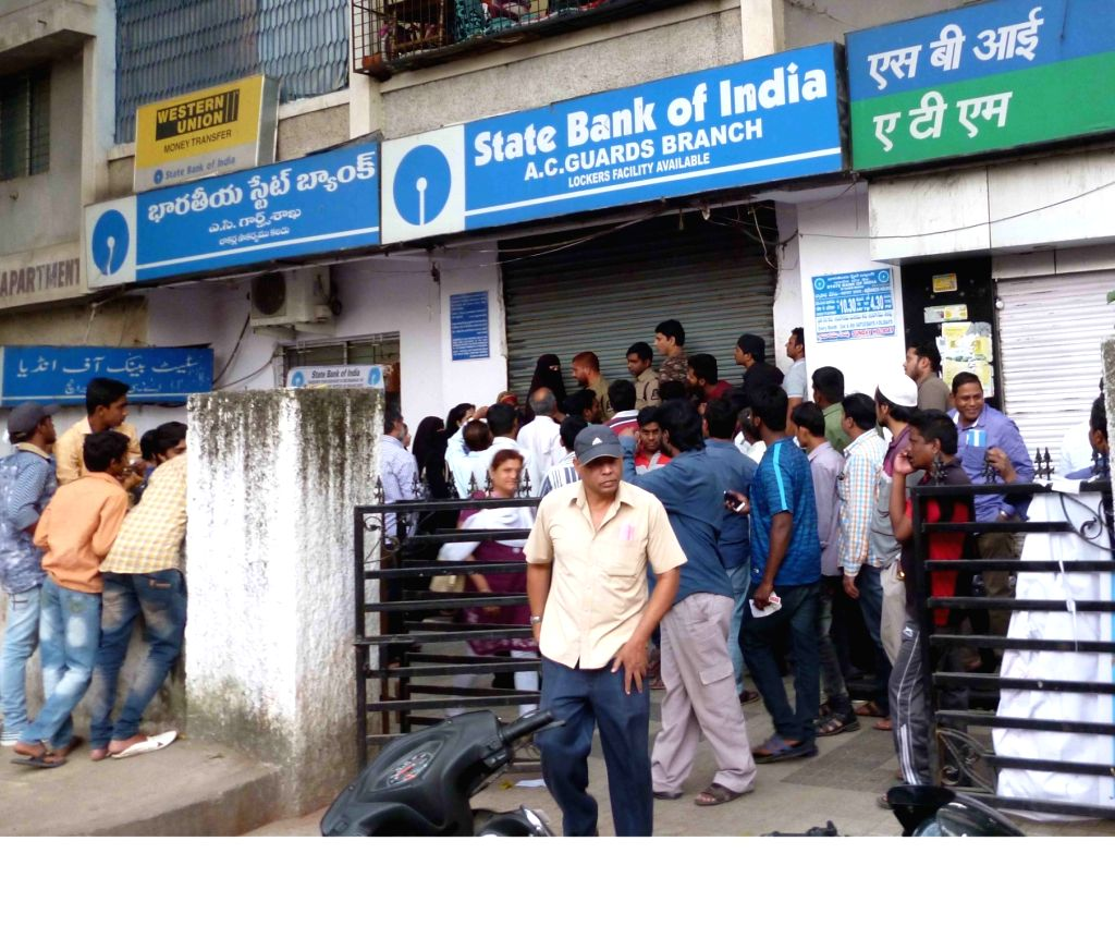 People queue up outside an ATM in Hyderabad on Nov 30, 2016.