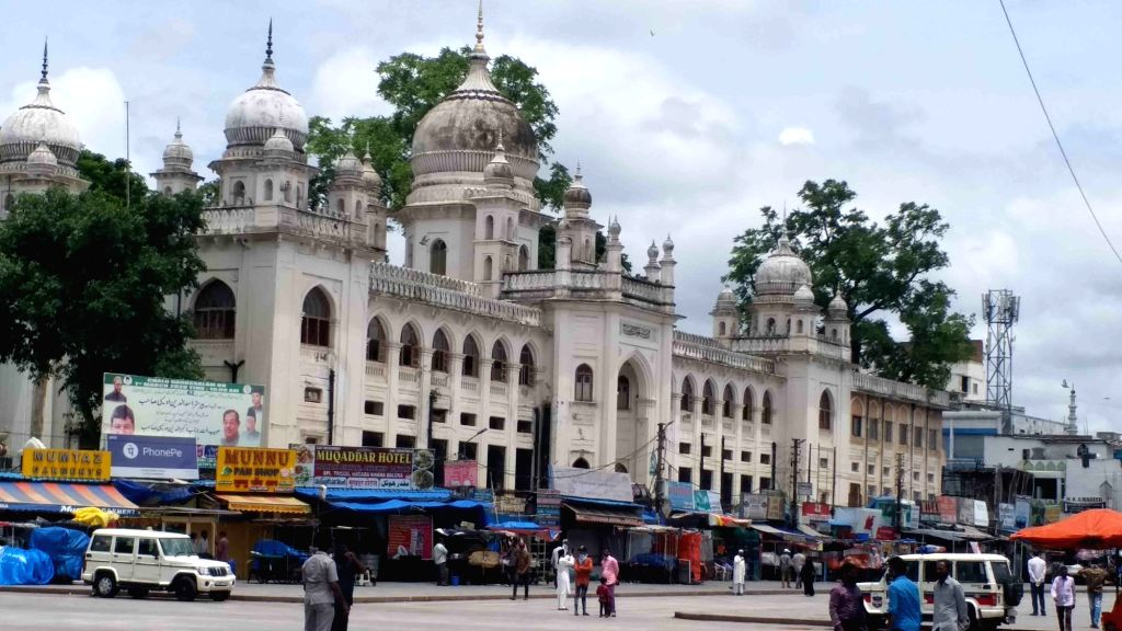 People queue up outside Charminar Unani (Nizamia General Hospital and Tibbi College) to submit samples for COVID-19 testing, amid rising cases of coronavirus in Hyderabad on July 3, 2020. ...