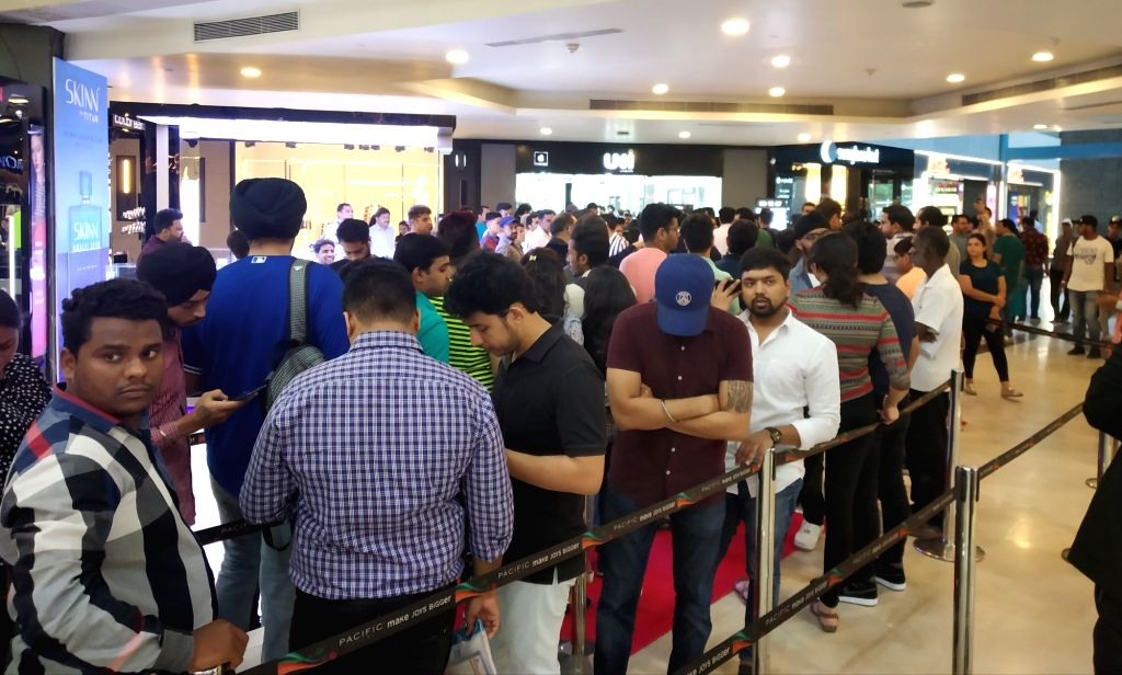 People queue up outside iWorld to purchase iPhones after the iPhone 11, iPhone 11 Pro, and iPhone 11 Pro Max smartphones went on sale across both online and offline retail stores in India; ...