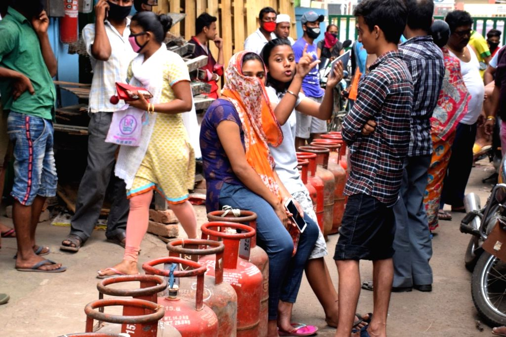 People queue up to buy LPG Gas cylinders on Day 2 of the 21-day nationwide lockdown imposed by the Narendra Modi government over the coronavirus pandemic; in Kolkata on March 26, 2020. - Narendra Modi