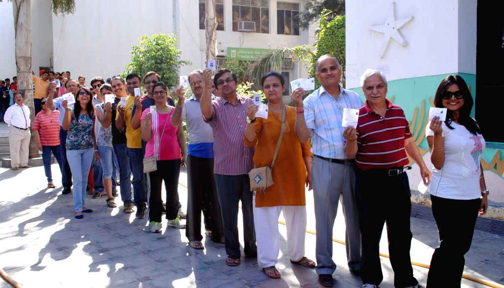 People queue-up to cast their votes at a polling booth during the third phase of 2014 Lok Sabha Polls in Gurgaon on April 10, 2014.