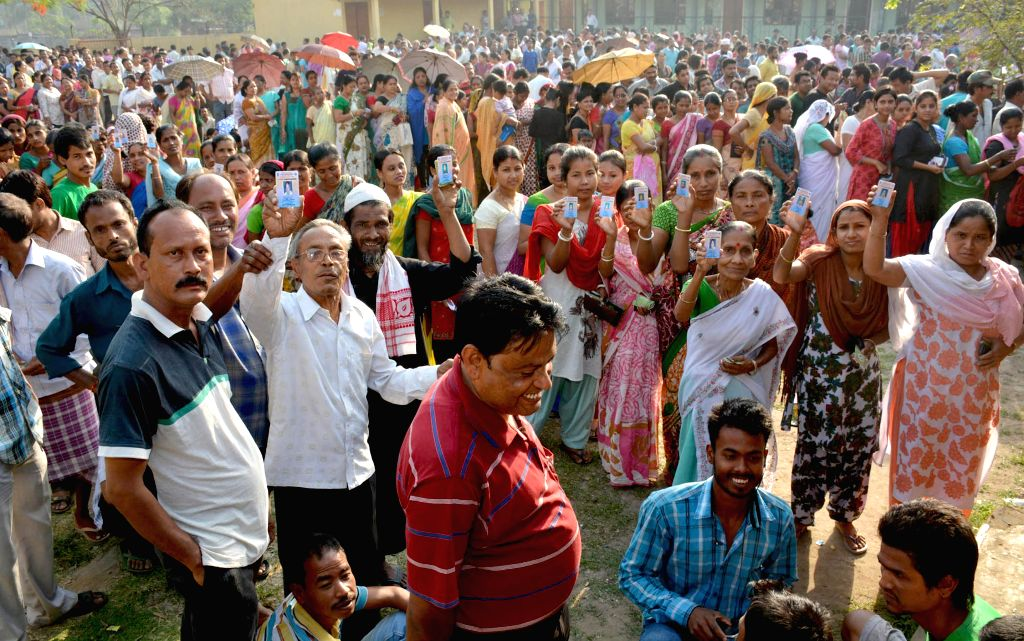 People queue-up to cast their votes at a polling booth at a polling booth during the sixth phase of 2014 Lok Sabha Polls in Guwahati on April 24, 2014.